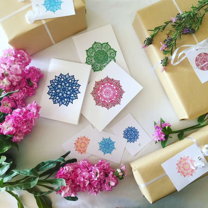 Dried and pressed flowers used as decorations inside gift cards