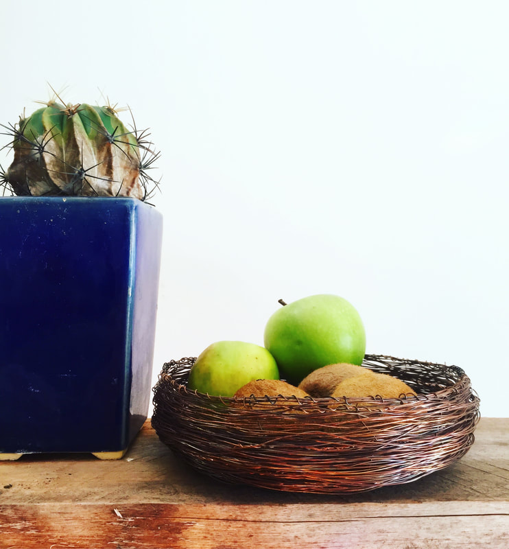 Fresh Australian fruit in a handcrafted copper bowl