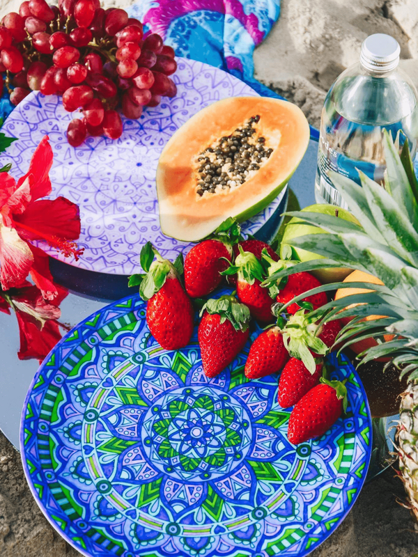 Sustainable picnic plates styled with tropical fruits and unique homewares