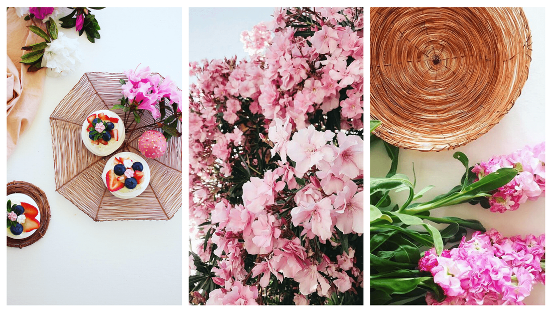 Beautiful and bespoke copper creations surrounded by pink flowers and pretty greenery